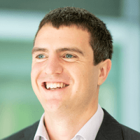 Sam Moat smiling, L&D Digital Lead at AlixPartners