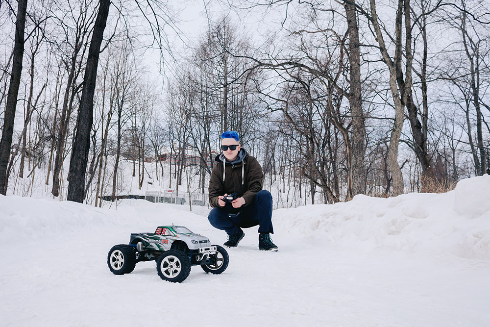 Aleksandr Muravev is playing with the radio-controlled car
